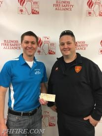Phil Zaleski, Ex. Dir. of IFSA (L) and PHFPD FF Jason Hardy (R) with Hardy's donation to the IFSA.