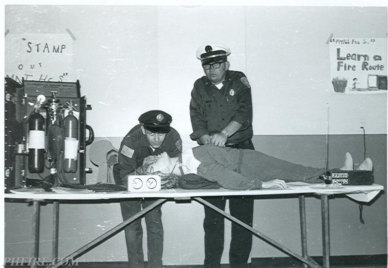 Ron (right) teaching CPR