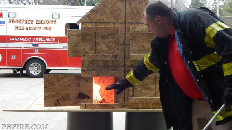 Instructor  Brian Kazmierzak reviews fire growth/ behavior with the duty crews