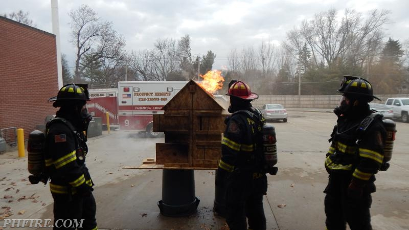 Fire behavior noted by crews simulating a hole cut in the roof