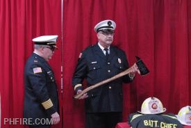 Chief Smith with BC Grzeslo holding ceremonial axe presented to Grzeslo in commemoration of his retirement