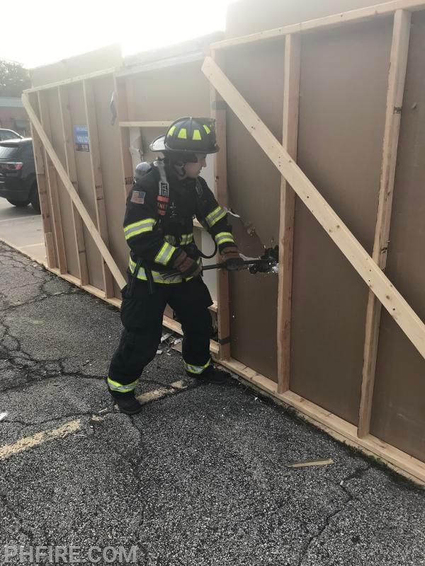 FF Senese demonstrating the proper way to breach walls.