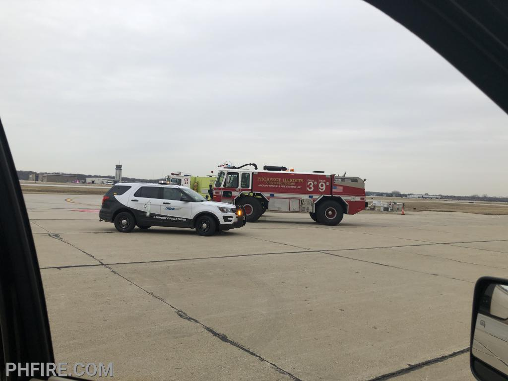 March 18 fire trucks stood by at Chicago Executive Airport while a plane with an emergency landed. Fortunately, no one was injured.