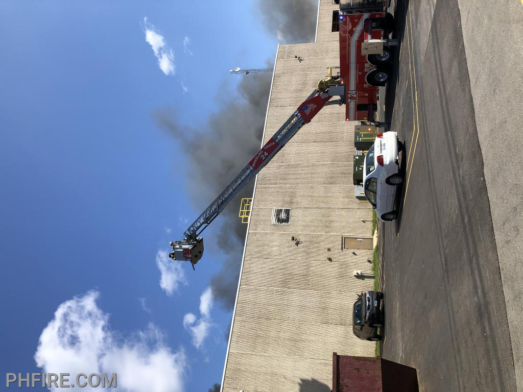 Wheeling aerial ladder being put to work as PHFD arrives to assist