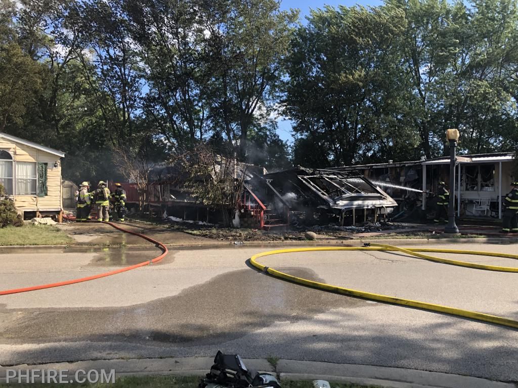 The center home was the first to catch fire. Homes immediately to its east and west ignited from the radiant heat prior to the arrival of the fire department.