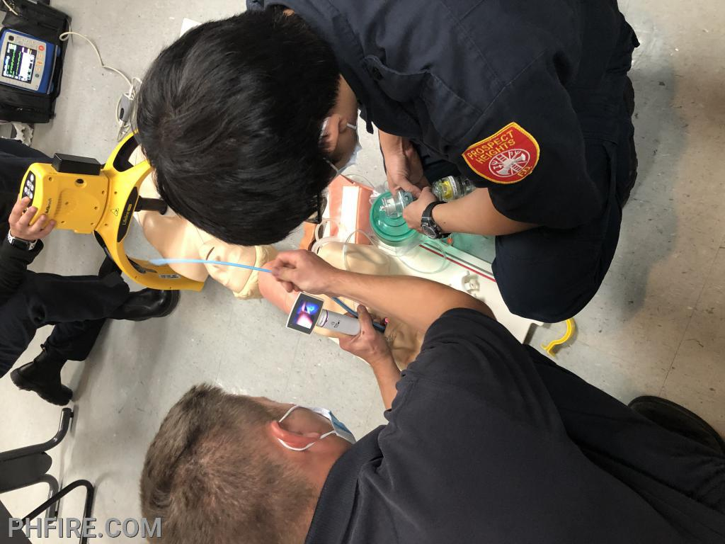 Paramedic practice placing an entrotraceal (breathing) tube into the patient's lungs using a video larygoscope.