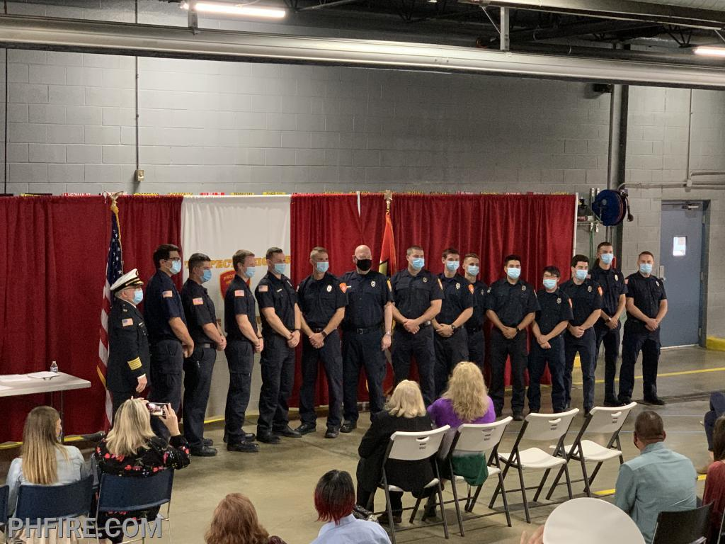 Chief Smith and the 14 new firefighters after the pinning of thier badges