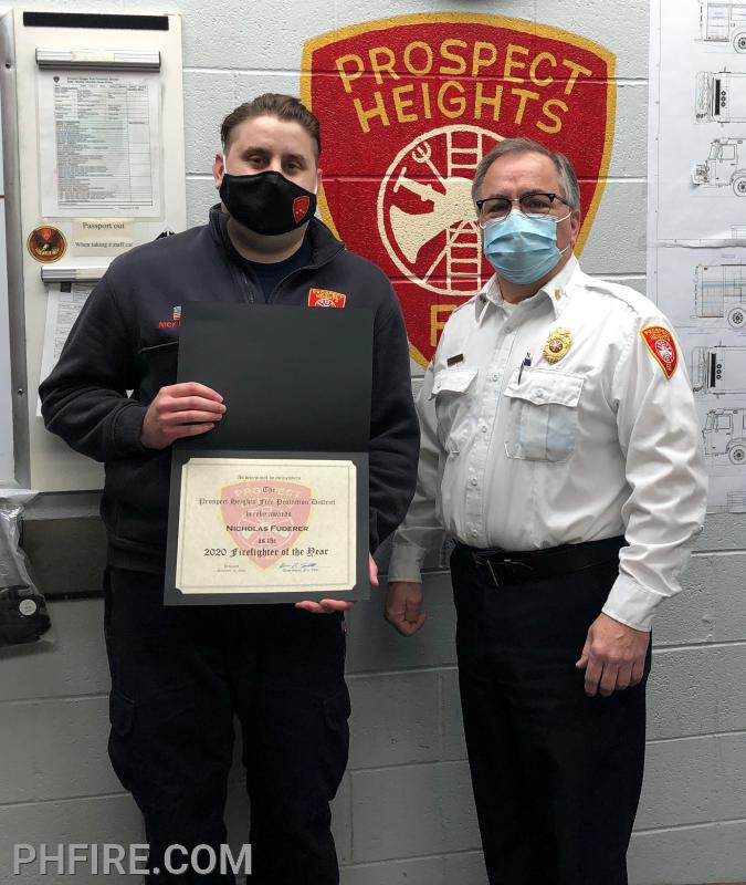 Firefighter of the Year Nick Fuderer (L) with Chief Smith