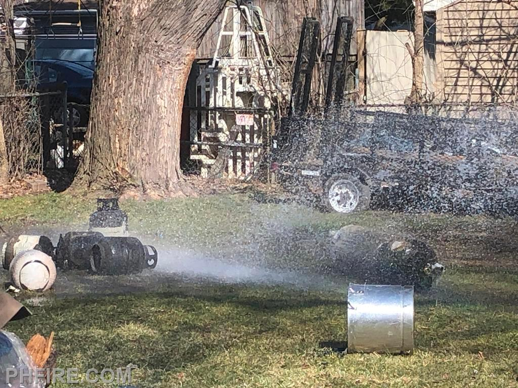Several 20-pound propane tanks (L) and one  200-pound tank were removed from the fire area. The large tank was leaking.