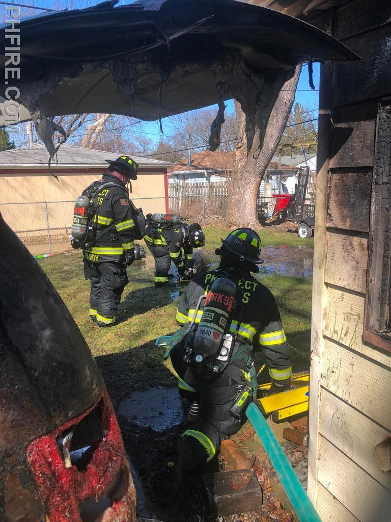 Firefighters work to control the leaking propane