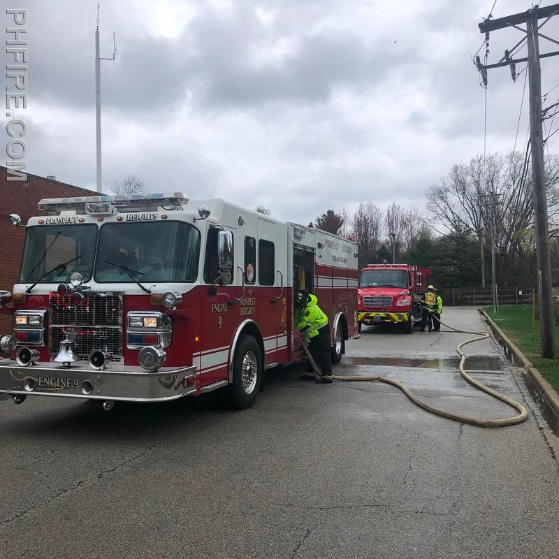 Engineer trainees practice relay pumping, the movement of water by one pumper to another over many hundred feet.