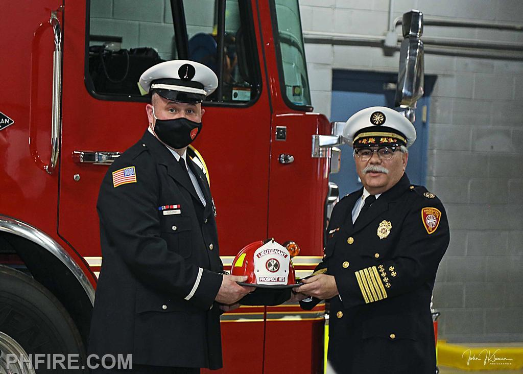 LT Hardy receiving his new helmet from Chief Smith